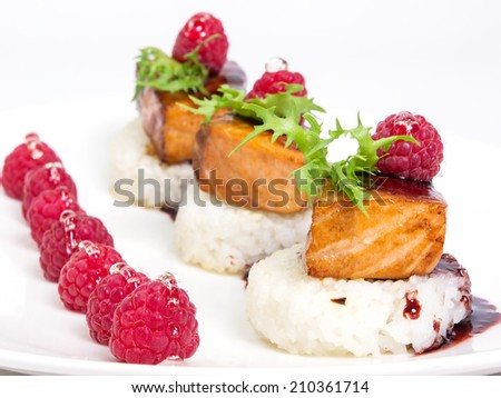 grilled salmon and rice decorated with raspberries and herbs. on white background - stock photo