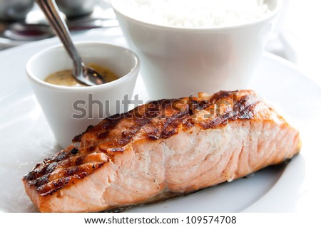 grilled salmon and rice-french cuisine dish with tomato and salmon - stock photo