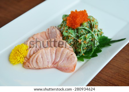 Grilled salmon and wakame - stock photo