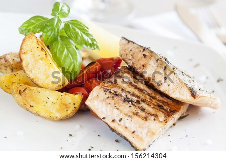 Grilled salmon filet with baked potatoes - stock photo