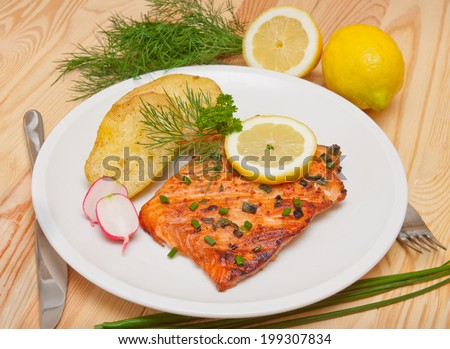 Grilled salmon fillet with boiled potatoes.