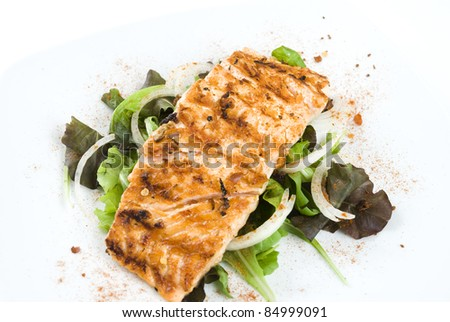Grilled salmon fillet with fresh vegetables - stock photo