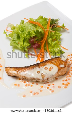 Grilled salmon in a creamy caviar sauce and lettuce.