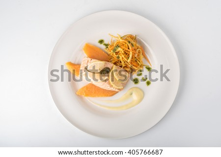 Grilled salmon, mango and salad on a plate