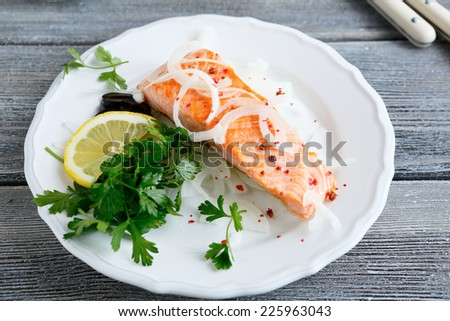 Grilled salmon on a white plate, food