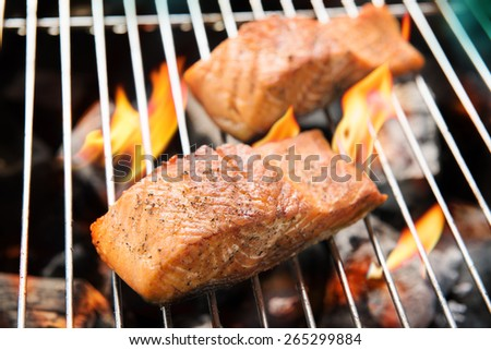 Grilled salmon on the flaming.