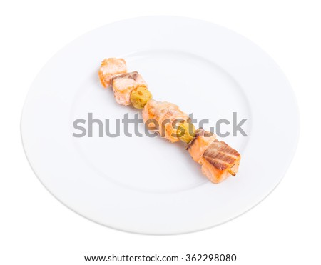 Grilled salmon shish kebab on skewer with olives. Isolated on a white background. - stock photo