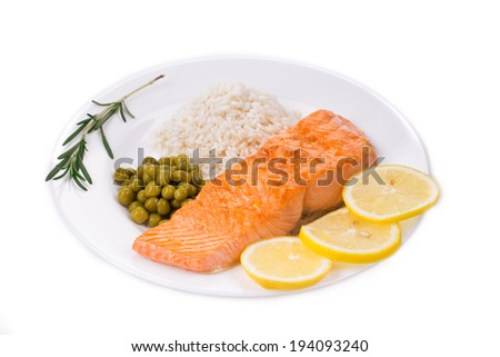 Grilled salmon steak with garnish. Isolated on a white background. - stock photo