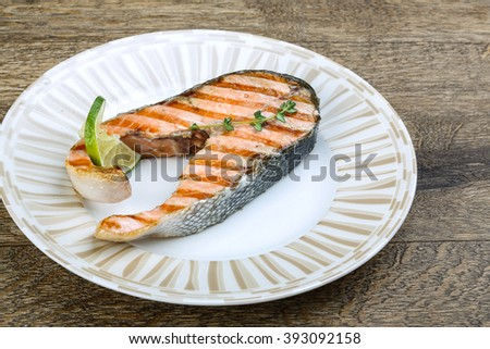 Grilled salmon steak with thyme and lime - stock photo