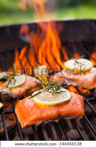 Grilled salmon steaks on fire - stock photo