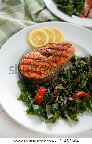 Grilled Salmon Steaks Served with Kale, Chard, Peppers and Fennel Green Salad - stock photo