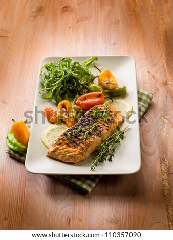 grilled salmon with capsicum and arugula - stock photo
