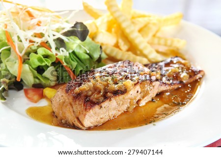 Grilled Salmon with fresh salad and potato fries