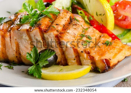 Grilled Salmon with fresh salad . Selective focus