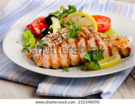 Grilled Salmon with fresh salad. Selective focus
