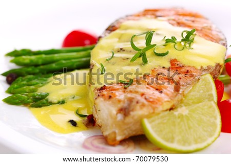 grilled salmon with lime, asparagus and saffron sauce with rosemary
