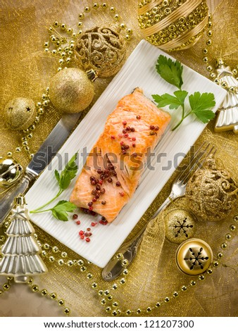 grilled salmon with pink pepper on christmas table