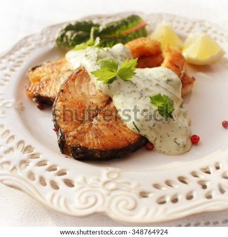 Grilled salmon with sauce - stock photo