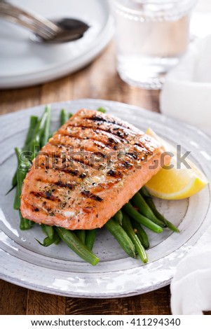 Grilled salmon with steamed green beans and lemon - stock photo