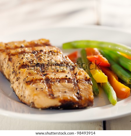 grilled salmon with vegetables closeup with natural sunlight