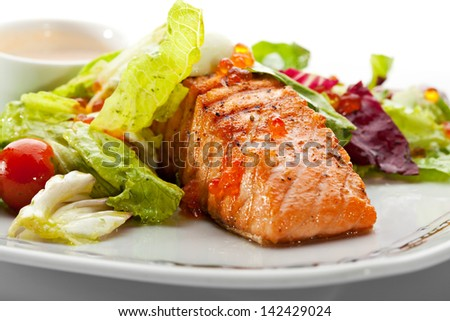 Grilled Salmon with Vegetables, Eggs and Sour Cream Sauce - stock photo