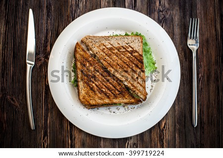 grilled sandwich on a wooden board - stock photo
