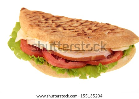 Grilled sandwich or panini with melting cheese, tomato, and spinach leaves, on wholewheat bread
