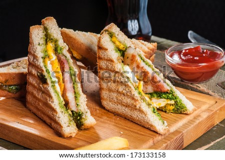 Grilled sandwiches with chicken and egg served with french fries - stock photo