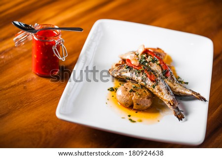 Grilled Sardines Plate with Red Pepper and Potato in a Portuguese Restaurant - stock photo