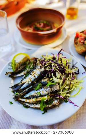 Grilled sardines, traditional Mediterranean dish - stock photo