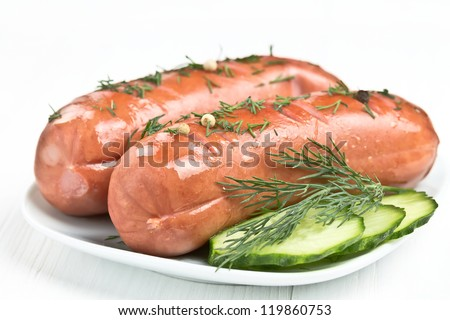 grilled sausage with dill and cucumber slices