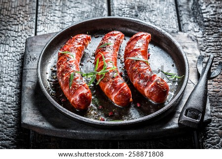 Grilled sausage with fresh rosemary - stock photo