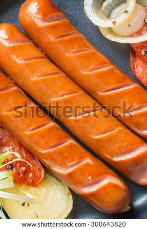 Grilled sausage with on hot barbecue dish