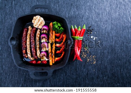 Grilled sausages with vegetables - stock photo