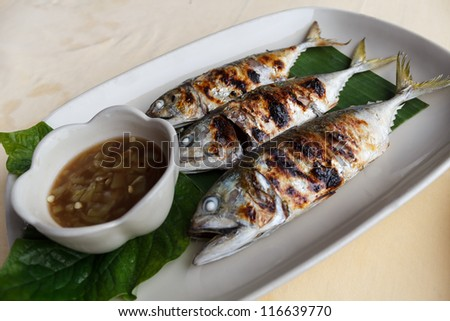 Grilled scomber fish with special fish sauce. - stock photo
