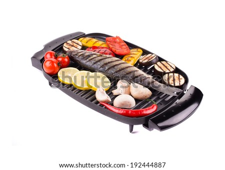 Grilled seabass on grill with vegetables. Isolated on a white background.