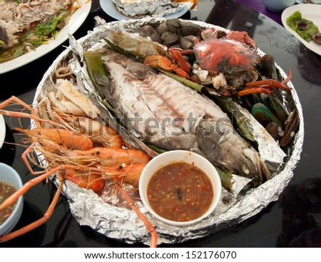 grilled seafood on restaurant table - stock photo