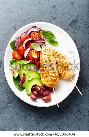 Grilled Sesame Chicken Skewers with Fresh Vegetables and Kalamata Olives  - stock photo