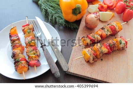 Grilled shashlick made with red and yellow pepper, onion and meat - stock photo
