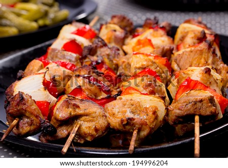 Grilled shashlik on the black plate,