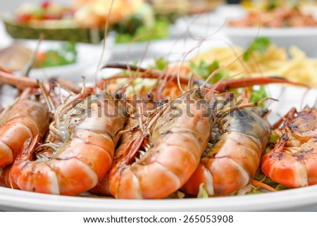 Grilled Shrimp in a plate on dining table - stock photo