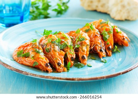 Grilled shrimp in sweet and sour sauce. - stock photo