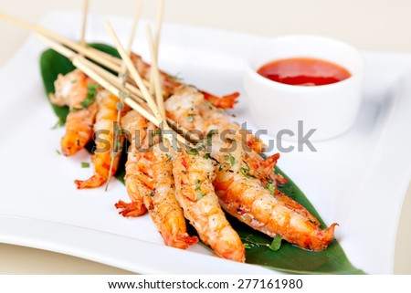 grilled shrimp on skewers with sauce - stock photo