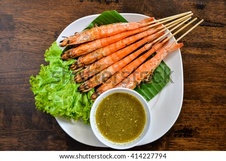 Grilled shrimp skewers and seafood  sauce  - stock photo