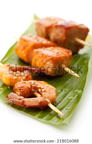 Grilled Shrimps, Salmon and Chicken Meat  Garnished on Green Banana Leaf - stock photo