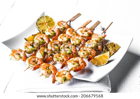 Grilled shrimps with limes - stock photo