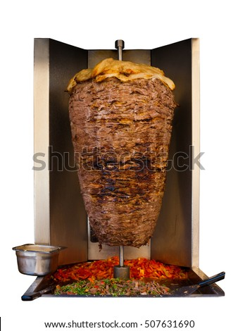 Grilled skewered lamb mutton, a traditional meat served in shawarma or kebab sandwich in the Mediterranean, Arab countries in Middle East cooking on spit in machine isolated on white background