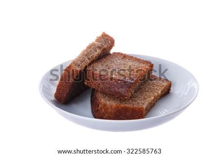 Grilled slices of rye bread on a white plate.