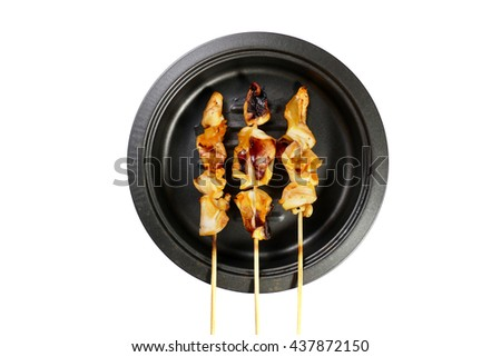 Grilled squid on frying pan over white background - stock photo