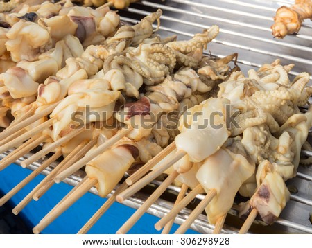Grilled squid on skewer - stock photo